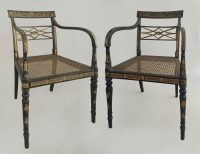 Pair of Regency Ebonized and Gilded Arm Chairs, Circa 1810