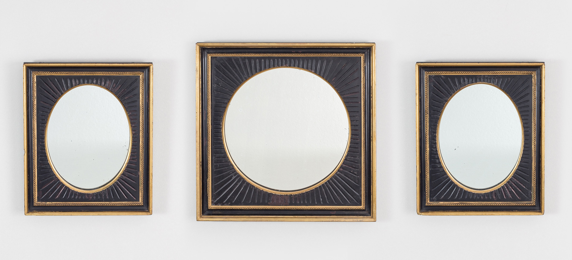 Set of Three Antique Ebonized and Gilded Mirrors